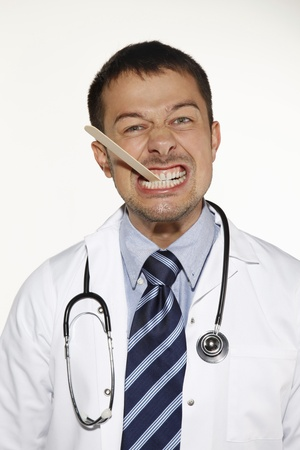 depressor: Doctor biting on a tongue depressor Stock Photo