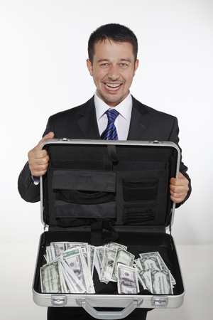 Businessman showing a briefcase of money photo