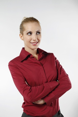 belarusian ethnicity: Businesswoman looking up while folding her arms Stock Photo