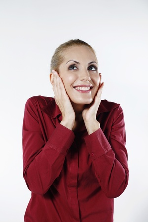 belarusian ethnicity: Businesswoman with her hands on cheeks while smiling