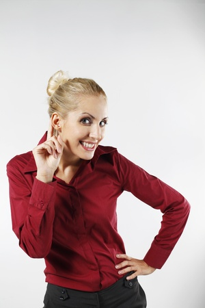 belarusian ethnicity: Businesswoman with finger to ear  Stock Photo
