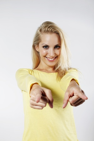 belarusian ethnicity: Woman smiling while pointing with her fingers