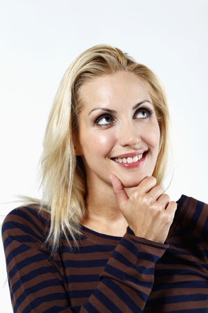 belarusian ethnicity: Woman touching her chin while thinking Stock Photo