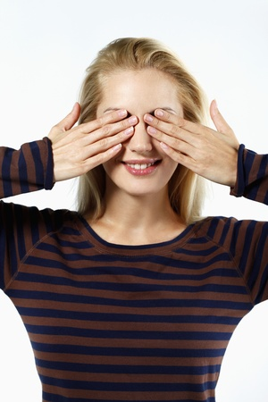 belarusian ethnicity: Woman covering her eyes with hands Stock Photo