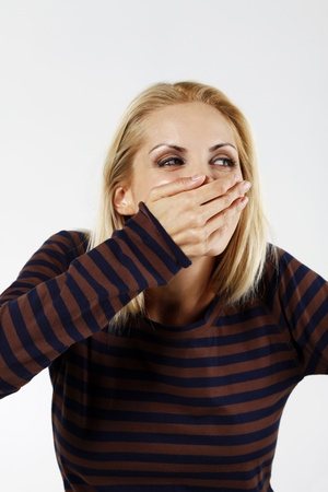 belarusian ethnicity: Woman covering her mouth with hand while giggling