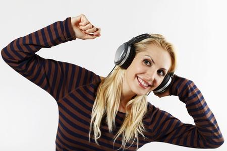 belarusian ethnicity: Woman listening to music on the headphones Stock Photo