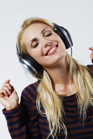 belarusian ethnicity: Woman listening to music on the headphones with her eyes closed