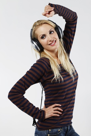 belarusian ethnicity: Woman dancing while listening to music on the headphones