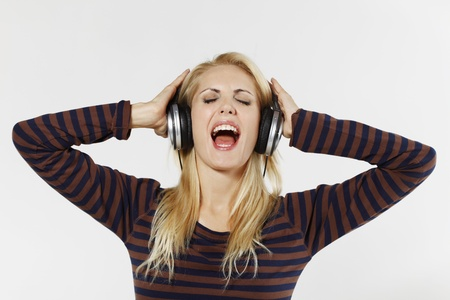 belarusian ethnicity: Woman singing while listening to music on the headphones