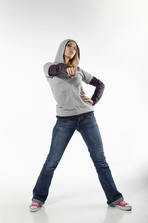 hooded shirt: Woman with hooded shirt pointing her finger Stock Photo
