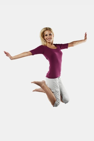 Woman jumping on a trampoline Stock Photo - 8735621