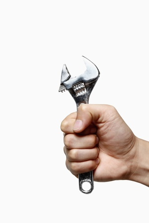Human hand holding a spanner Stock Photo - 8735657
