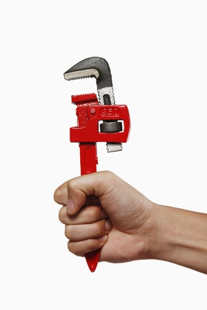 Human hand holding a wrench Stock Photo - 8735665