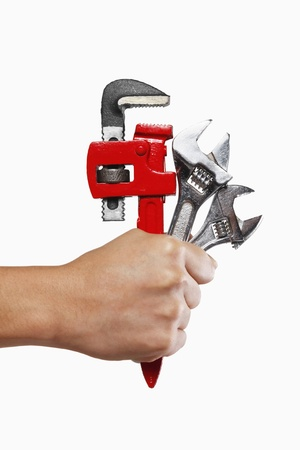 Human hand holding wrenches photo