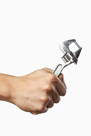 Human hand holding a spanner Stock Photo - 8735670