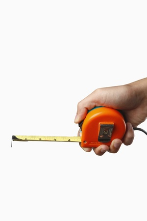 Human hand holding tape measure photo