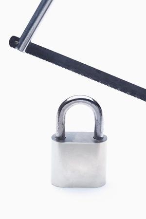 Hacksaw and a padlock photo