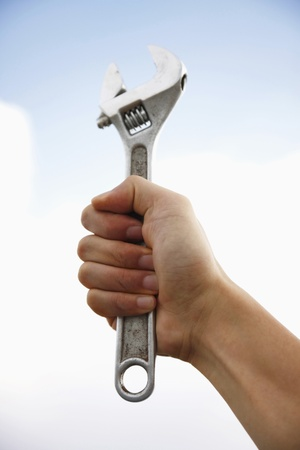 Human hand holding a spanner photo
