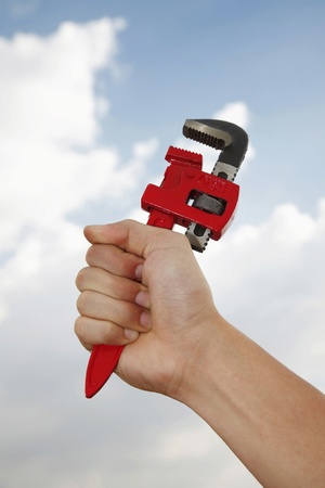 Human hand holding adjustable wrench photo