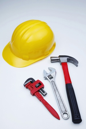 things that go together: Hardhat and wrenches Stock Photo
