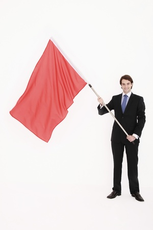 Businessman standing with red flag in his hands Stock Photo - 8757983