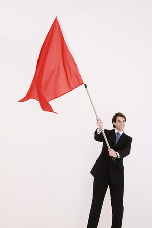 Businessman waving a red flag Stock Photo - 8758337