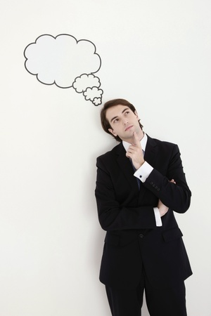 Businessman standing with thought bubble above his head Stock Photo - 8771638