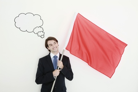 Businessman holding a red flag with thought bubble above his head Stock Photo - 8758076