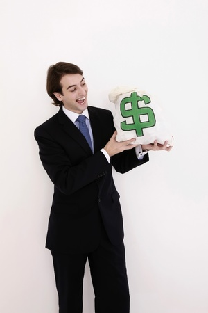 Businessman smiling at money bag Stock Photo - 8758023