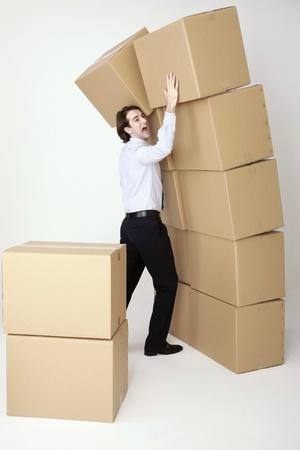 Businessman stopping stacked boxes from falling down Stock Photo - 8758079