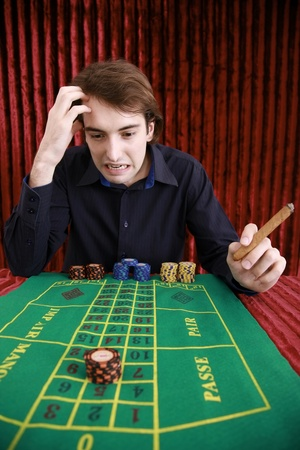 Man looking stressed at roulette table Stock Photo - 8758491