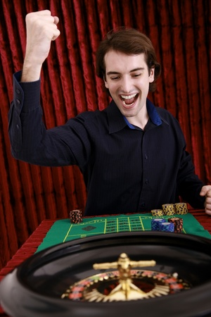 Man winning at roulette in casino photo