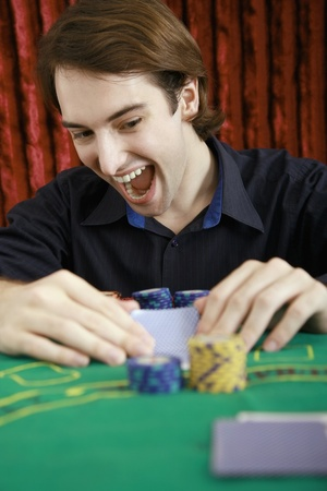 Man looking at playing cards photo