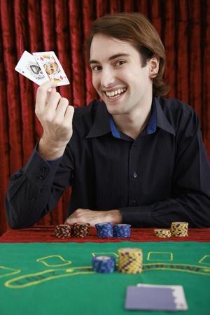 Man holding up winning cards