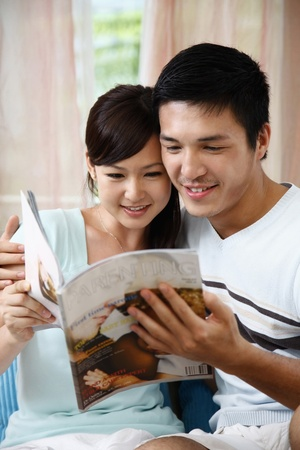 Man and woman reading magazine Stock Photo - 8758250