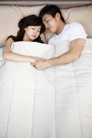 Man and woman sleeping in bed photo