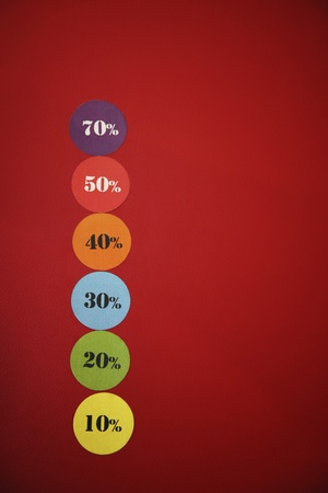 Colorful price tags on red background photo