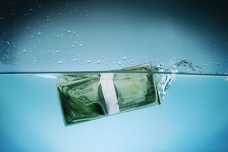 money risk: Currency underwater Stock Photo