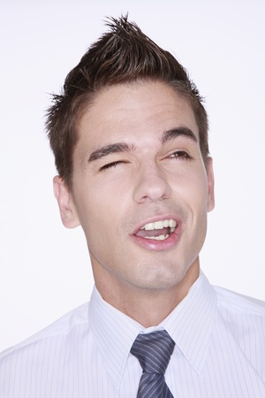 Businessman with one eye closed photo