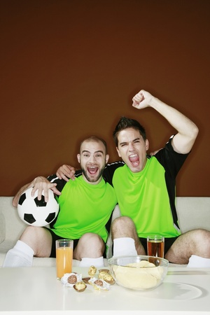 Men watching football match on the television photo