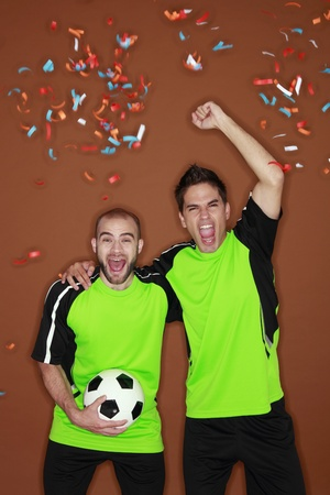 sport celebration:  Men cheering while watching football match at home Stock Photo