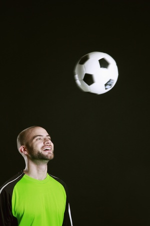 Man playing with football Stock Photo - 8980885