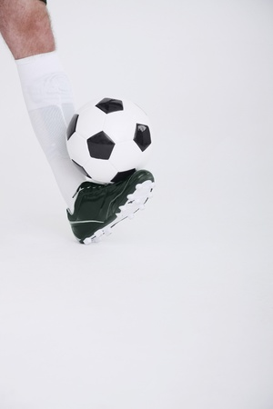 Man dribbling football Stock Photo - 8980823