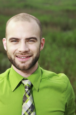 Businessman in green shirt smiling photo