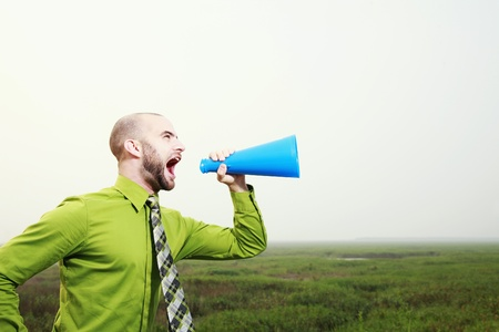 Businessman shouting through a megaphone Stock Photo - 8980871
