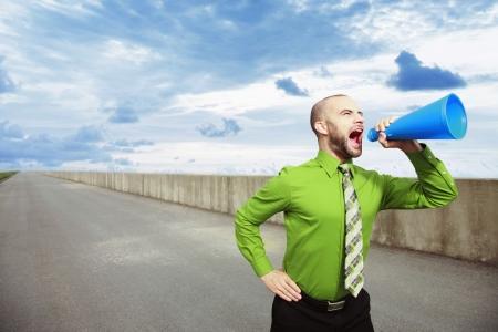 Businessman shouting through a megaphone Stock Photo