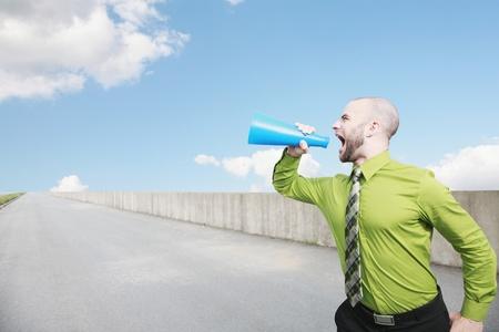 Businessman shouting through a megaphone photo