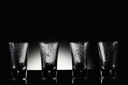 Shot glasses on wet table Stock Photo - 8980961