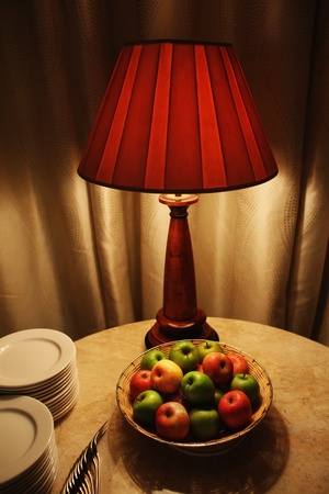 Fruits on coffee table in a hotel room photo