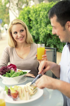 Man and woman having a meal at an outdoor restaurant Stock Photo - 8981094